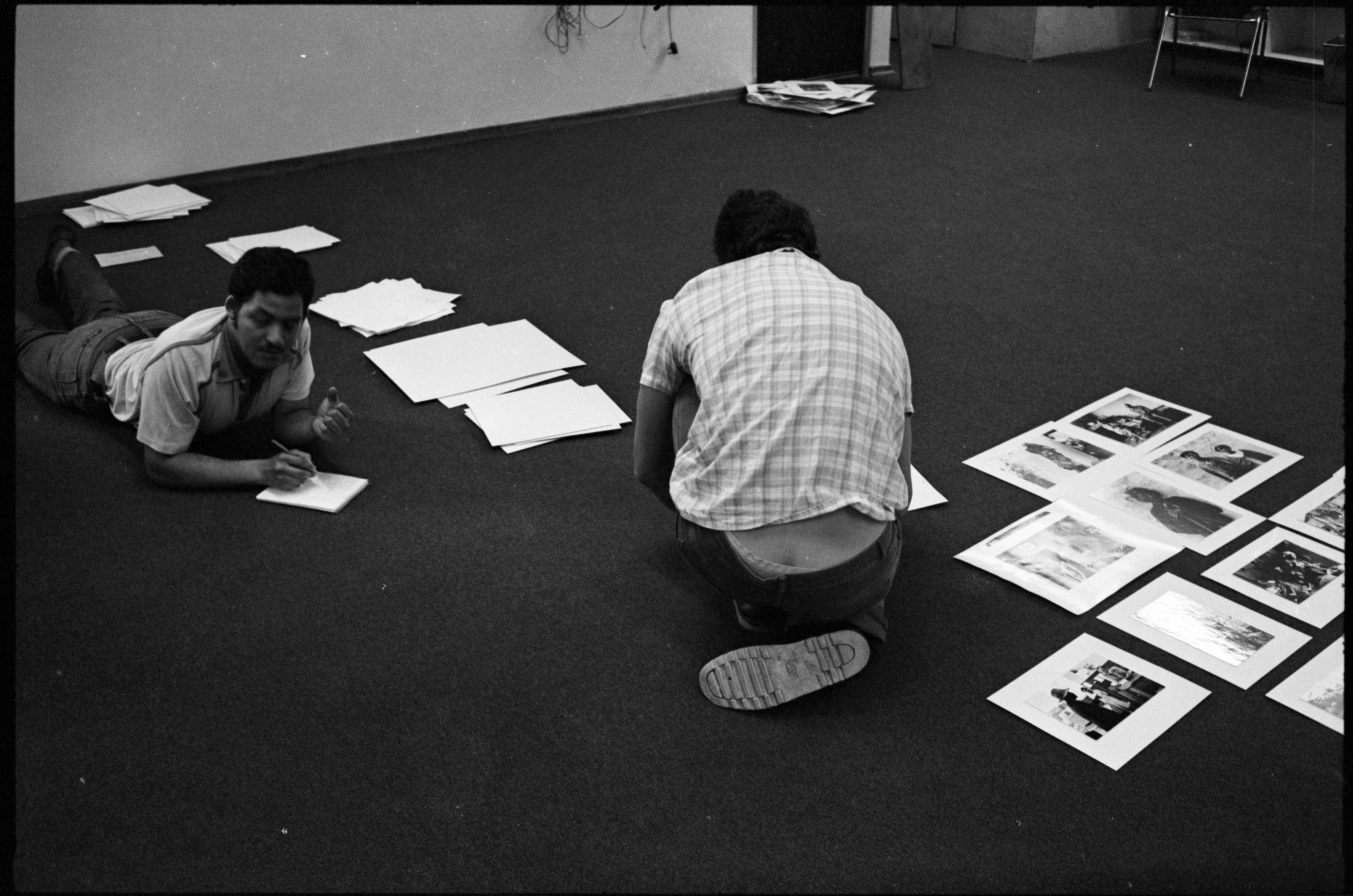 Paul Weinberg and Chris Van Wyk selecting images for the first Staffrider exhibition 1983