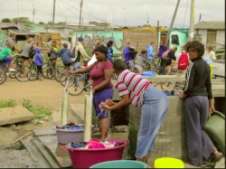 https://footstepstofreedom.co.za/wp-content/gallery/langa-tours/washing-clothes-in-langa.jpg