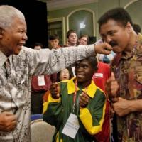 Mandela lands a playful left hook on Muhammad Ali